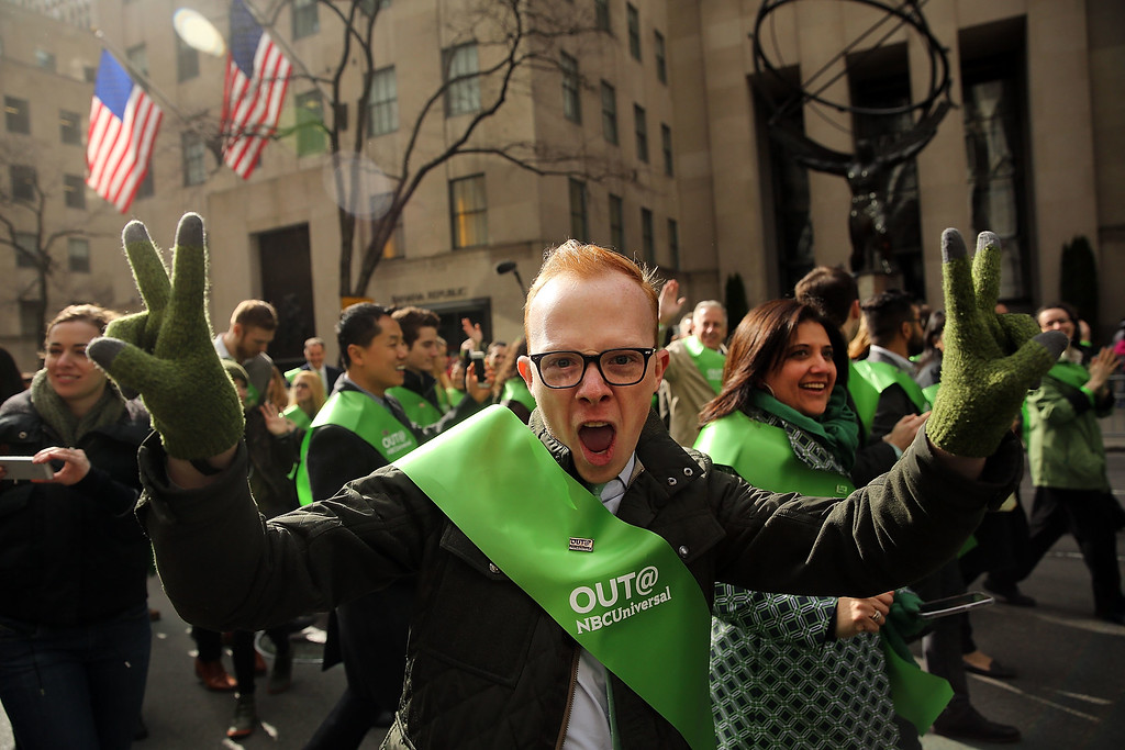 . Members of the first openly gay group, OUT@NBCUniversal, make their way up 5th Avenue during New York City\'s St. Patrick\'s Day Parade on March 17, 2015 in New York City. Despite a policy shift that is allowing a gay group to march for the first time in the parade\'s history, New York Mayor Bill de Blasio has refused to march in the city\'s parade. (Photo by Spencer Platt/Getty Images)