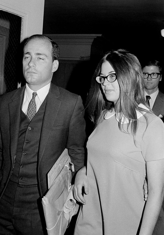 ". FILE - In this Sept. 23, 1970 file photo, Barbara Hoyt, 19, former member of Charles Manson\'s hippie ""family\"" arrives at court to testify as a prosecution witness in the Tate-La Bianca murder trial in Los Angeles. On Aug. 9, 1969, two naive 17-year-olds were launched on a path toward the most unlikely of friendships. That infamous night four young people under the sway of a charismatic career criminal slipped into a home in a neighborhood of Hollywood glitterati, then bludgeoned and stabbed rising young actress Sharon Tate, her friend and coffee heiress Abigail Folger, and two others. (AP Photo/Wally Fong, File)"