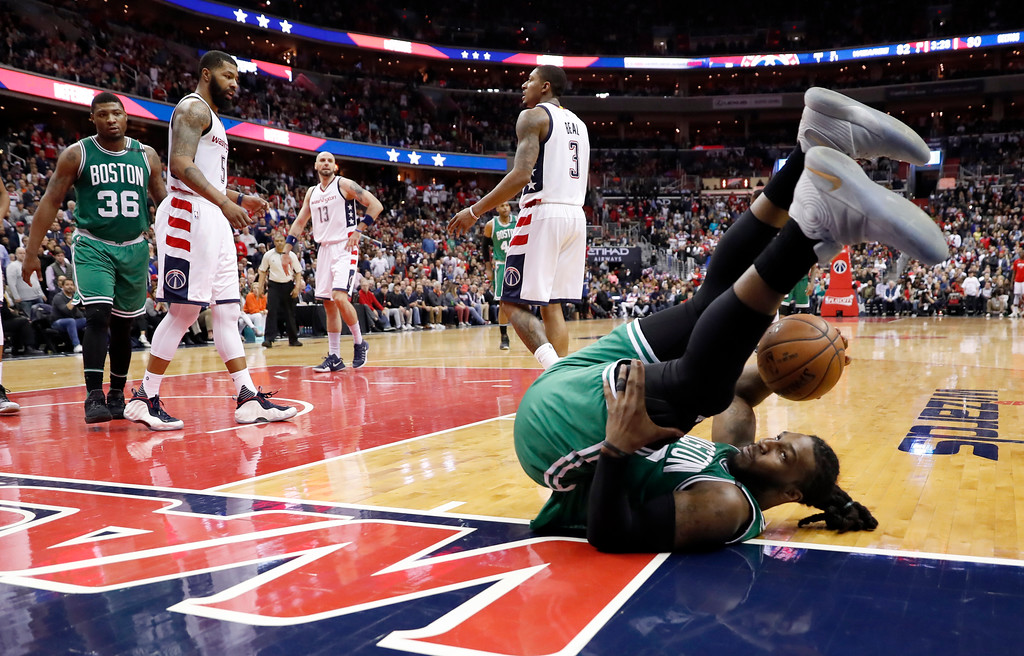 . Boston Celtics forward Jae Crowder (99) rolls over after being fouled during the second half of Game 6 of the team\'s NBA basketball second-round playoff series against the Washington Wizards, Friday, May 12, 2017, in Washington. The Wizards won 92-91. (AP Photo/Alex Brandon)