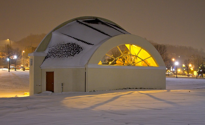 Band shell at night in a snowstorm.