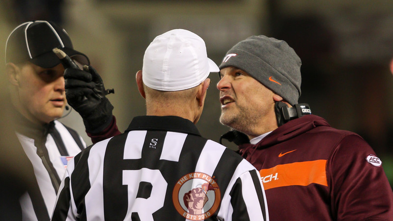 Head coach Justin Fuente argues with the referees while pointing at a replay of an uncalled penalty on Hokievision. (Mark Umansky/TheKeyPlay.com)