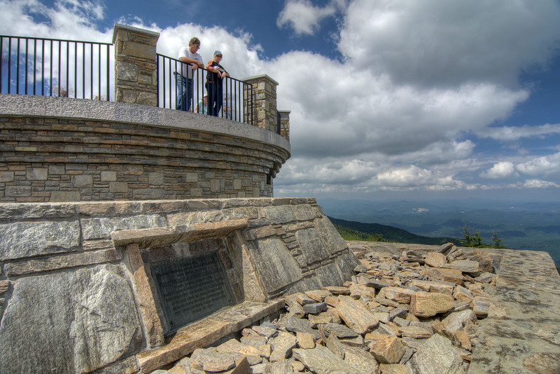 The grave of Elisha Mitchell, the geologist who first noted the peak of the mountain, at the observation deck atop Mt. Mitchell in Mount Mitchell State Park at Milepost 355.4 on the Blue Ridge Parkway in NC on Saturday, June 15, 2013. Copyright 2013 Jason Barnette