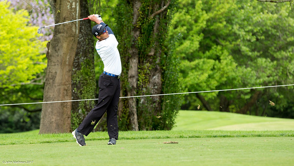 Kshitij Naveed Kaul hitting the ball on the 17th fairway on the 1st day of competition in the Asia-Pacific Amateur Championship tournament 2017 held at Royal Wellington Golf Club, in Heretaunga, Upper Hutt, New Zealand from 26 - 29 October 2017. Copyright John Mathews 2017.   www.megasportmedia.co.nz