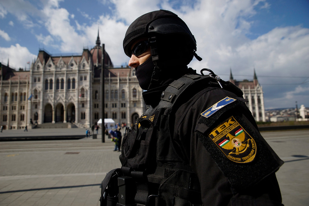 . A member of the Counter Terrorism Centre (TEK) patrols the area in front of the Parliament in downtown Budapest, Hungary, Tuesday, March 22, 2016. Hungary raised its terrorism awareness level to grade 2 after a series of attacks in Brussels. (Zoltan Balogh/MTI via AP)