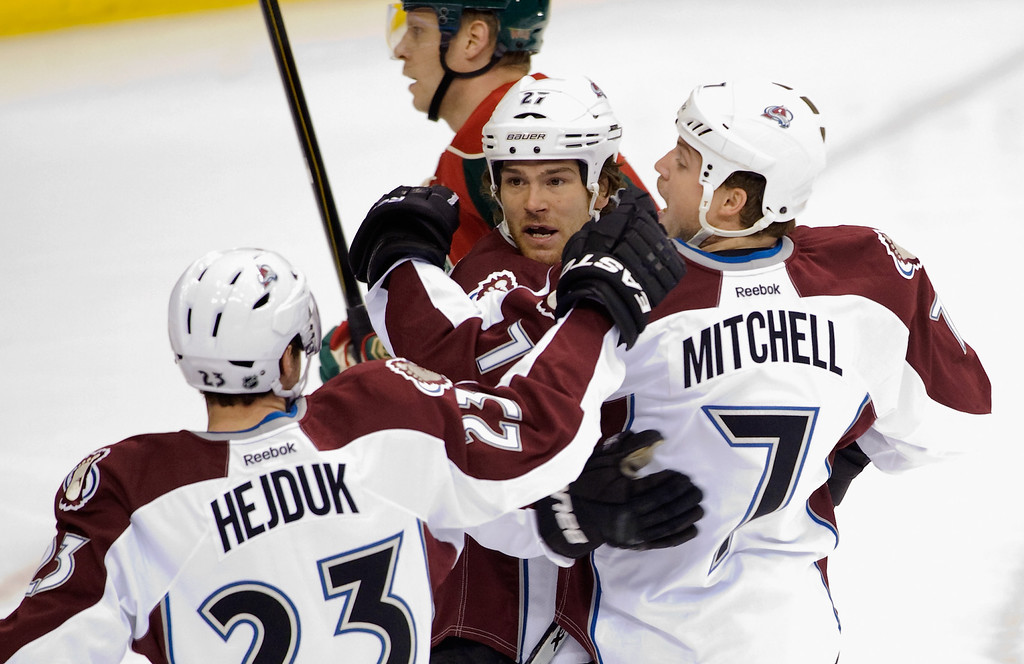 . ST PAUL, MN - JANUARY 19:  Milan Hejduk #23 and Steve Downie #27 of the Colorado Avalanche congratulate John Mitchell #7 on a goal during the first period of their season opener against the Minnesota Wild on January 19, 2013 at Xcel Energy Center in St Paul, Minnesota. (Photo by Hannah Foslien/Getty Images)