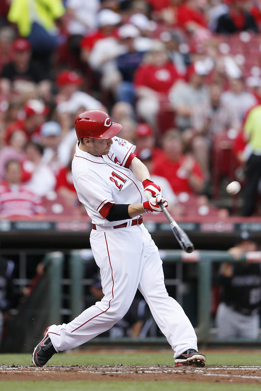 . CINCINNATI, OH - MAY 9: Todd Frazier #21 of the Cincinnati Reds hits a home run in the bottom of the second inning of the game against the Colorado Rockies at Great American Ball Park on May 9, 2014 in Cincinnati, Ohio. (Photo by Joe Robbins/Getty Images)