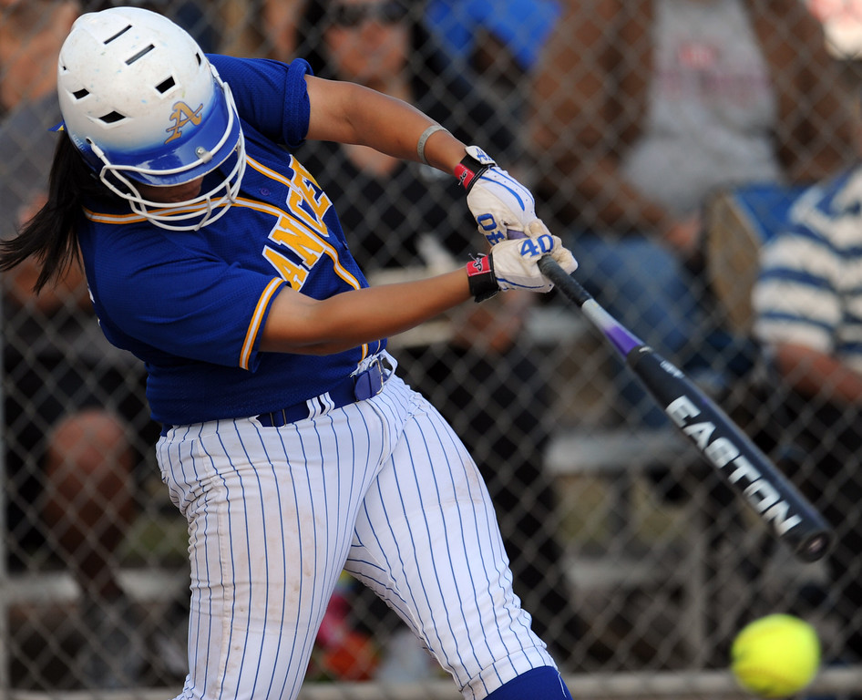 . Bishop Amat\'s Alexis Gonzalez (C) doubles in the sixth inning of a prep softball game against Santiago at Bishop Amat High School on Wednesday, March 27, 2013 in La Puente, Calif. Bishop Amat won 5-3.  (Keith Birmingham Pasadena Star-News)