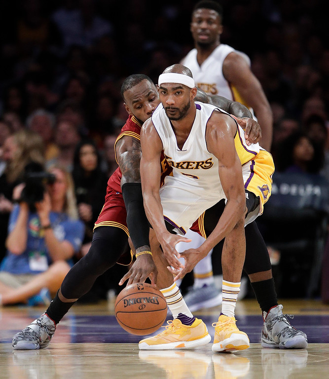 . Cleveland Cavaliers\' LeBron James, left, steals the ball from Los Angeles Lakers\' Corey Brewer during the second half of an NBA basketball game Sunday, March 19, 2017, in Los Angeles. The Cavaliers won 125-120. (AP Photo/Jae C. Hong)