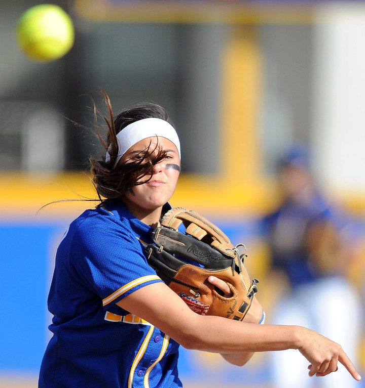 . Bishop Amat shortstop Victoria Saucedo throws out Santiago\'s Kaylin Crumpton (not pictured) in the fifth inning of a prep softball game at Bishop Amat High School on Wednesday, March 27, 2013 in La Puente, Calif. Bishop Amat won 5-3.  (Keith Birmingham Pasadena Star-News)