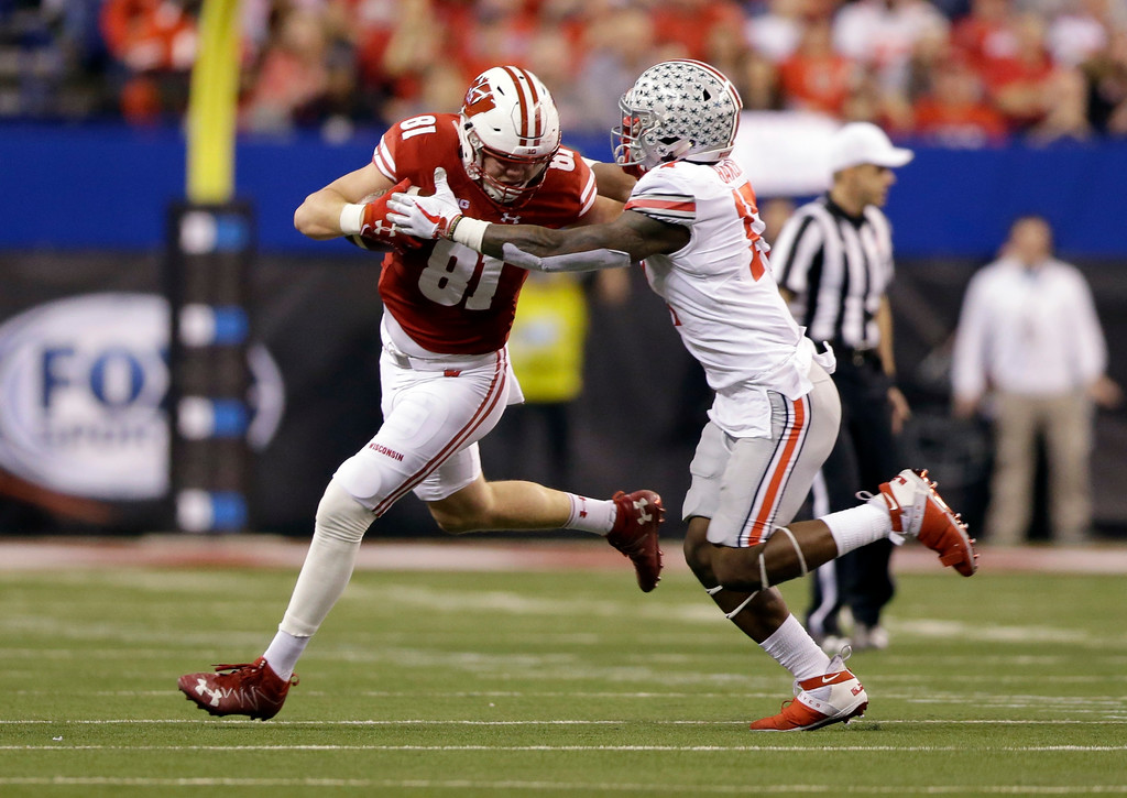 . Wisconsin tight end Troy Fumagalli, left, runs past Ohio State linebacker Jerome Baker during the first half of the Big Ten championship NCAA college football game, Saturday, Dec. 2, 2017, in Indianapolis. (AP Photo/AJ Mast)