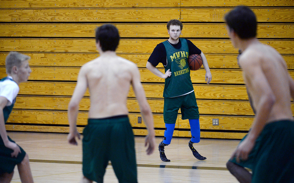 . HIGHLANDS RANCH, CO - JANUARY 30, 2014: Mountain Vista basketball player Bailey Roby, 18, practices with the team in the school\'s gym at 10585 Mountain Vista Ridge in Highlands Ranch, Co on January 31, 2014.   Roby, 18, who is a senior has played basketball for 2 years.  CHSSA has ruled that Roby is ineligible to play basketball because of safety concerns.  (Photo By Helen H. Richardson/ The Denver Post)