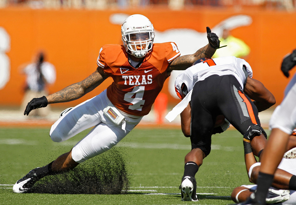 . Safety Kenny Vaccaro #4 of the Texas Longhorns attempts a first quarter tackle of running back Joseph Randall #1 of the Oklahoma State Cowboys on October 15, 2011 at Darrell K. Royal-Texas Memorial Stadium in Austin, Texas.  Vaccaro was selected 15th by the New Orleans Saints in the 2013 NFL Draft. (Photo by Erich Schlegel/Getty Images)