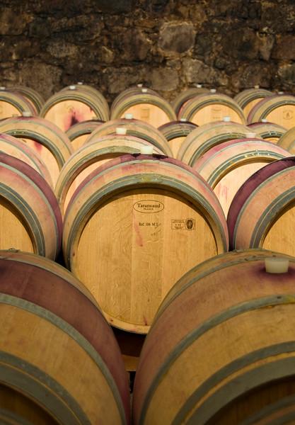 Wine Aging in Oak Barrels in Cellar in Bolzano (Bozen), Trentino-Alto Adige, Italy