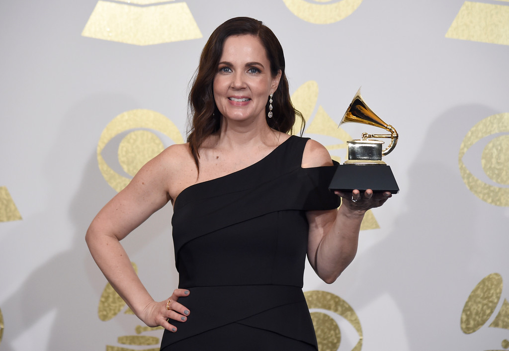 ". Songwriter Lori McKenna poses in the press room with the award for best country song for ""Humble and Kind\"" by Tim McGraw at the 59th annual Grammy Awards at the Staples Center on Sunday, Feb. 12, 2017, in Los Angeles. (Photo by Chris Pizzello/Invision/AP)"
