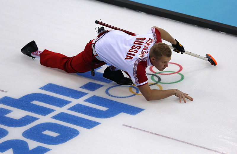 . Russia\'s Alexey Stukalskiy throws a stone during the men\'s curling round robin session 3 match between Russia and Norway at the Ice Cube curling centre in Sochi on February 11, 2014 during the 2014 Sochi winter Olympics. (ADRIAN DENNIS/AFP/Getty Images)