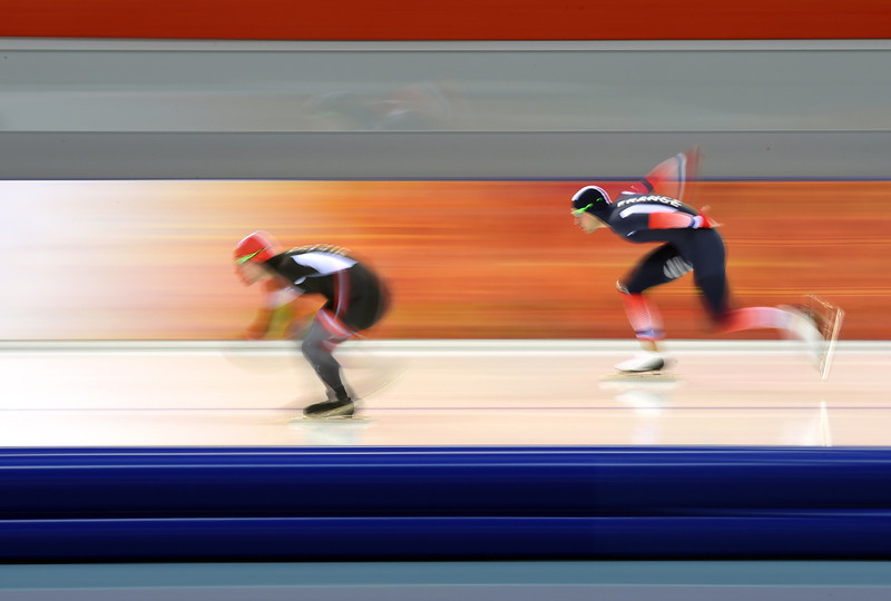 . France\'s Benjamin Mace (R) and Latvia\'s Haralds Silovs compete in the Men\'s Speed Skating 1000 m at the Adler Arena during the Sochi Winter Olympics on February 12, 2014. (DAMIEN MEYER/AFP/Getty Images)