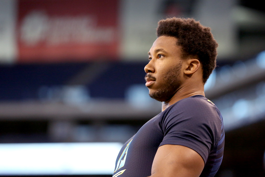 . Texas A&M defensive end Myles Garrett is seen before a drill at the 2017 NFL football scouting combine Sunday, March 5, 2017, in Indianapolis. (AP Photo/Gregory Payan)