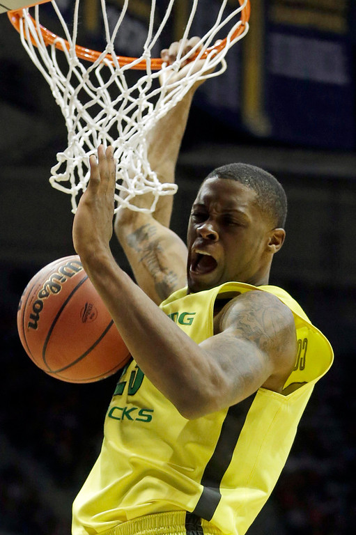 . Oregon forward Elgin Cook (23) dunks during the second half of a second-round game against the BYU in the NCAA college basketball tournament Thursday, March 20, 2014, in Milwaukee. (AP Photo/Morry Gash)