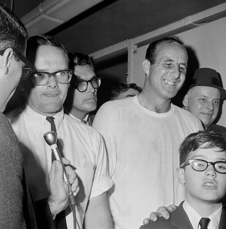 """. Kansas City Chiefs owner Lamar Hunt, left, visits the Green Bay Packers dressing room and congratulates Max McGee, right, who scored two touchdowns for the Packers in their 35-10 victory in the Super Bowl in Los Angeles on Jan. 15, 1967. Newsmen said Hunt told McGee the Packers have a fine team, \""""the kind of team we\'ll have some day.\""""  (AP Photo)"""