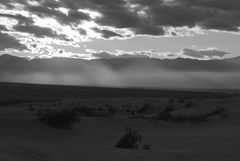Sunlight through the clouds and the Panamint range in the back