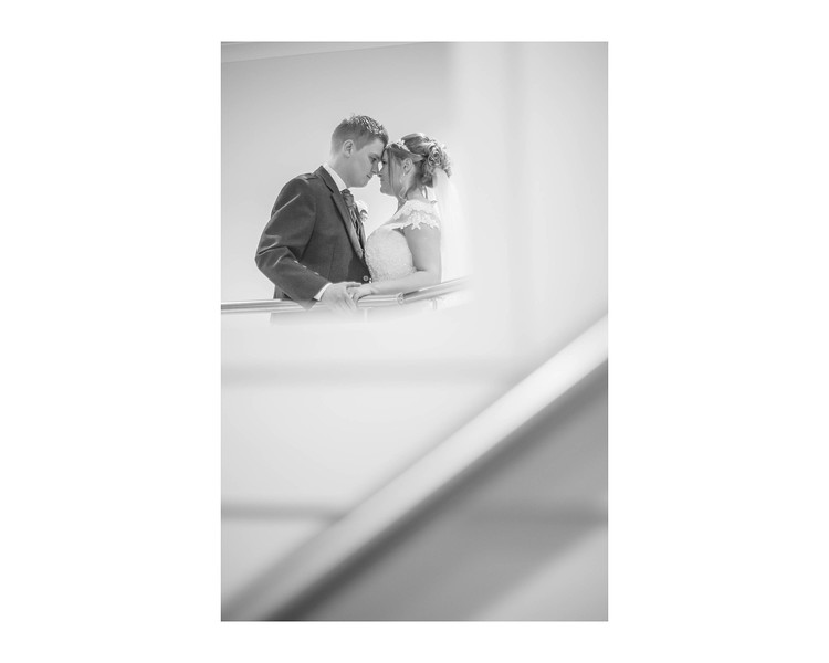 Wedding Photography of Laura & Graham, Stirling Court Hotel, Stirling Universaty Stirling, Scotland Photograph is of the Bride & Groom framed by the stairs and landing in Stirling Court Hotel