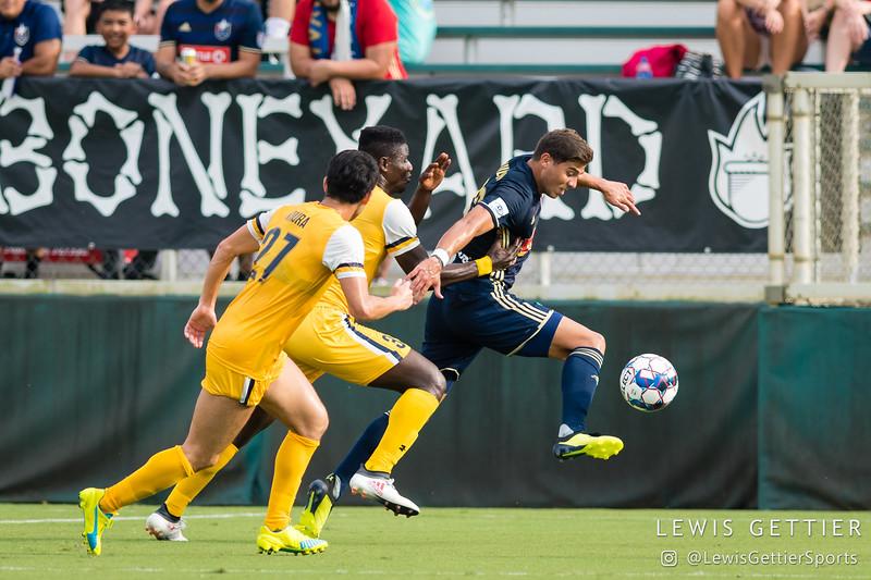 Nashville SC defender Kosuke Kimura (27), Nashville SC defender Bradley Bourgeois (22), and North Carolina FC defender Aaron Guillen (33)