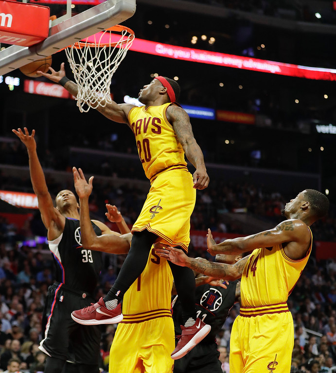 . Cleveland Cavaliers\' Kay Felder, top, jumps to grab a rebound during the second half of an NBA basketball game against the Los Angeles Clippers Saturday, March 18, 2017, in Los Angeles. (AP Photo/Jae C. Hong)