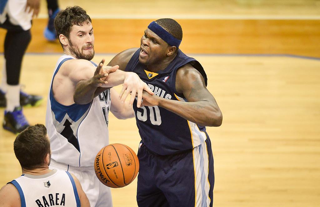 . Minnesota Timberwolves power forward Kevin Love fouls Memphis Grizzlies power forward Zach Randolph hard late in the fourth quarter. (Pioneer Press: Ben Garvin)