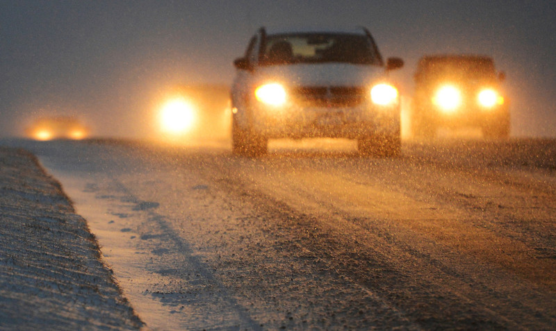 . Snow continues to falls though out much of the metro area, Tuesday, December 18, 2012, slowing the morning rush hour diver along Wadsworth Blvd. in Westminster.  RJ Sangosti, The Denver Post