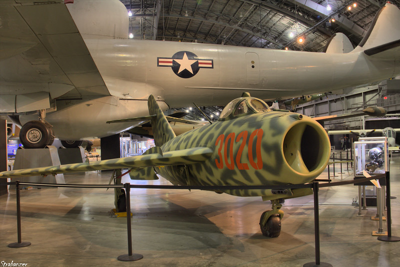 National Museum of the United States Air Force, Dayton, Ohio,   04/13/2019  Mikoyan-Gurevich MiG-17F c/n 0799 2302 (Ex Egyptian AF)  displayed as NVAF 3020.    Behind is EC-121D Warning Star  c/n 1049A-4370  53-0555   This work is licensed under a Creative Commons Attribution- NonCommercial 4.0 International License.