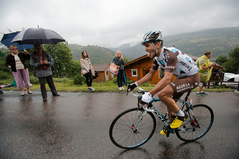 . Stage winner France\'s Blel Kadri strains as he climbs during the eighth stage of the Tour de France cycling race over 161 kilometers (100 miles) with start in Tomblaine and finish in Gerardmer, France, Saturday, July 12, 2014. (AP Photo/Christophe Ena)