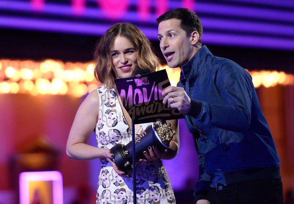 . Emilia Clarke, left, and Andy Samberg present the award for best fight at the MTV Movie Awards at Warner Bros. Studio on Saturday, April 9, 2016, in Burbank, Calif. (Kevork Djansezian/Pool Photo via AP)