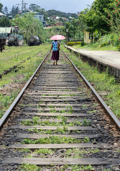 Woman Walks on Railway Track