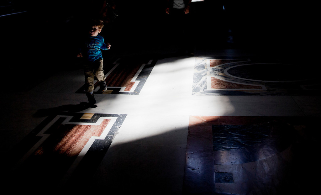 . A child plays inside St. Peter\'s Basilica at the Vatican, Thursday, April 24, 2014. Hundred thousands of pilgrims and faithful are expected to reach Rome to attend the scheduled April 27 ceremony at the Vatican in which Pope Francis will elevate in a solemn ceremony John XXIII and John Paul II to sainthood. (AP Photo/Alessandra Tarantino)