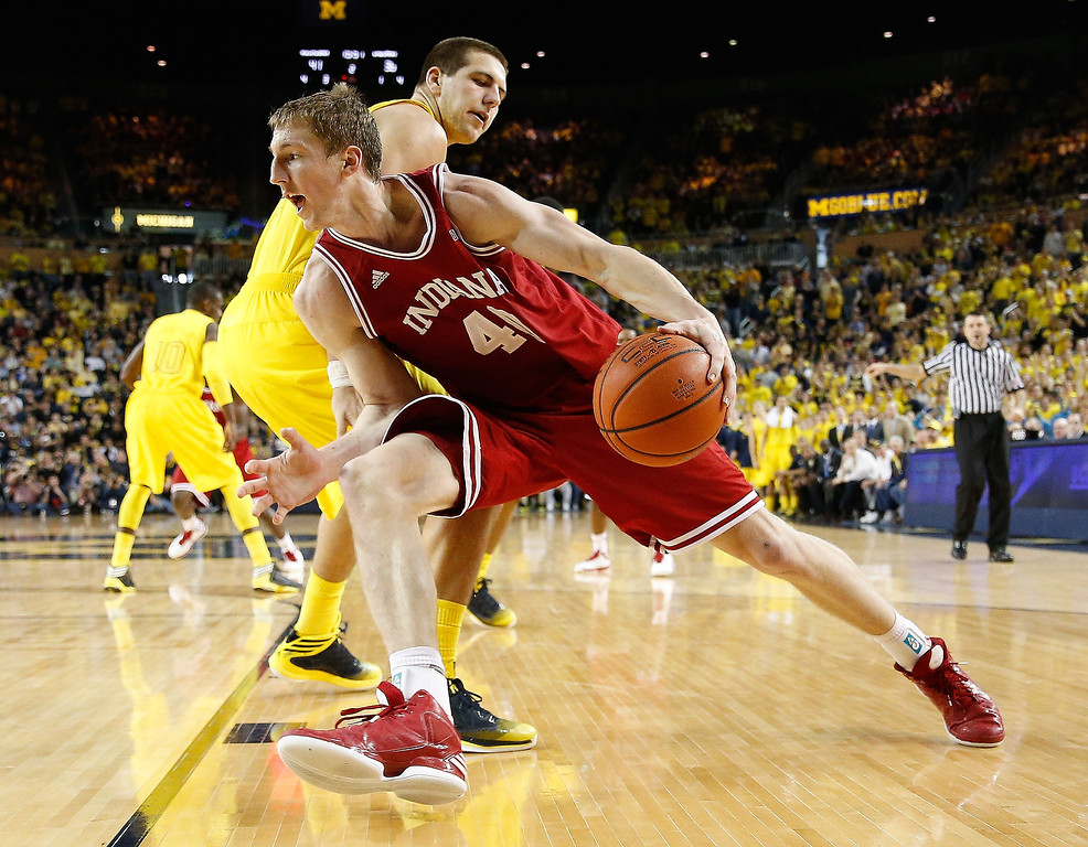 . Cody Zeller #40 of the Indiana Hoosiers drives around Mitch McGary #4 of the Michigan Wolverines during the second half at Crisler Center on March 10, 2013 in Ann Arbor, Michigan. Zeller was elected by the Charlotte Bobcats in the first round of the NBA basketball draft.(Photo by Gregory Shamus/Getty Images)