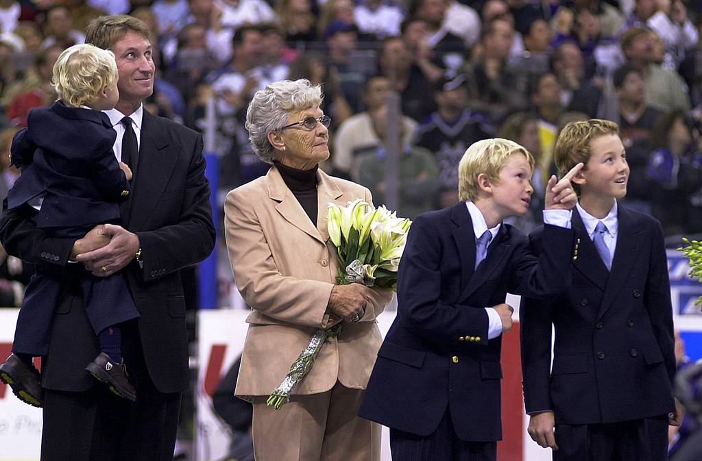 . Former Los Angeles Kings star Wayne Gretzky holds his two-year-old son Tristan as his jersey number is retired Wednesday, Oct. 9, 2002, in Los Angeles. Also joining Gretzky are his mother, Phyllis, and sons Trevor and Ty, far right. (AP Photo/E.J. Flynn)
