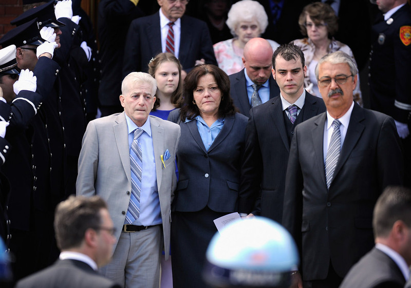 . Patty Cambell (3rd L), mother of Krystle Campbell, a victim of the Boston Marathon bombing, and brother Billy Campbell (2nd R) walk out of  St. Joseph Catholic Church after the funeral service on April 22, 2013 in Medford, Massachusetts. A manhunt ended for Dzhokhar A. Tsarnaev, 19, a suspect in the Boston Marathon bombing after he was apprehended on a boat parked on a residential property in Watertown, Massachusetts. His brother Tamerlan Tsarnaev, 26, the other suspect, was shot and killed after a car chase and shootout with police. The bombing, on April 15 at the finish line of the marathon, killed three people and wounded at least 170.  (Photo by Kevork Djansezian/Getty Images)