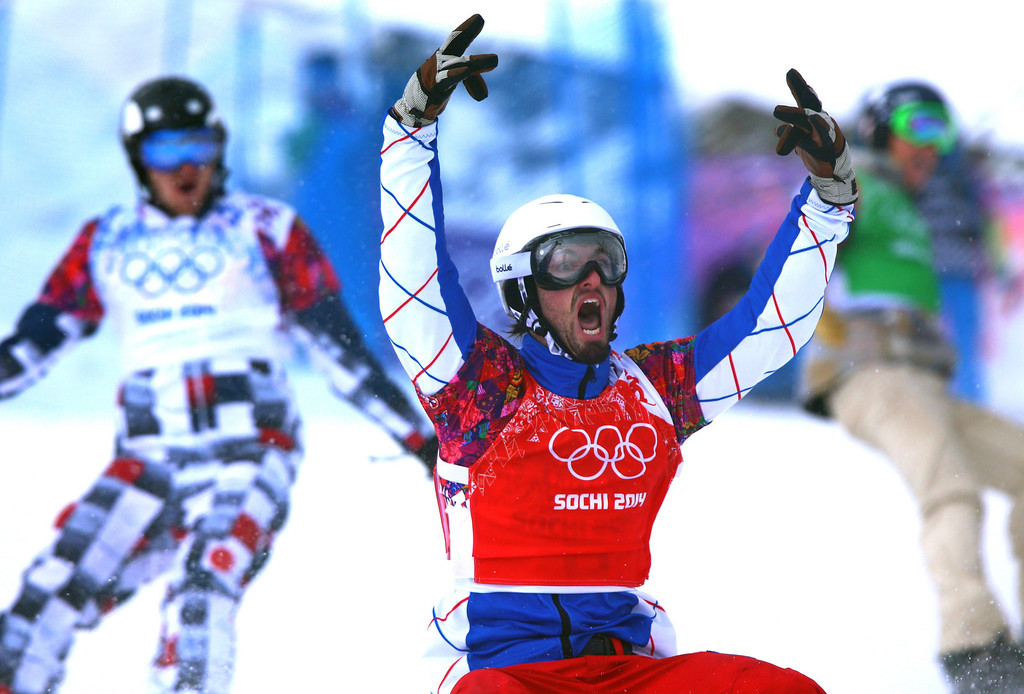 . Pierre Vaultier of France celebrates after winning gold in the Menës Snowboard Cross at Rosa Khutor Extreme Park at the Sochi 2014 Olympic Games, Krasnaya Polyana, Russia, 18 February 2014.  EPA/JENS BUETTNER