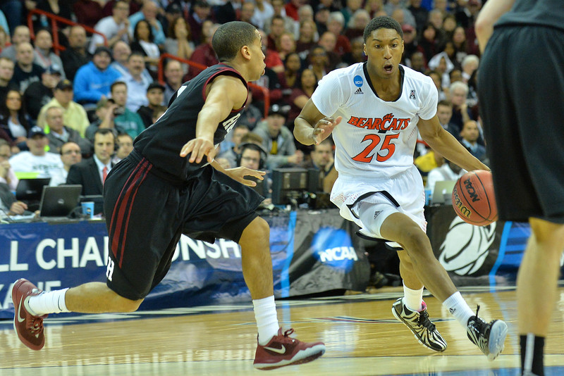 March 20, 2014: Cincinnati Bearcats guard Kevin Johnson (25) drives into the paint during a second round game of the NCAA Division I Men's Basketball Championship between the 5-seed Cincinnati Bearcats and the 12-seed Harvard Crimson at Spokane Arena in Spokane, Wash. Harvard defeated Cincinnati 61-57.