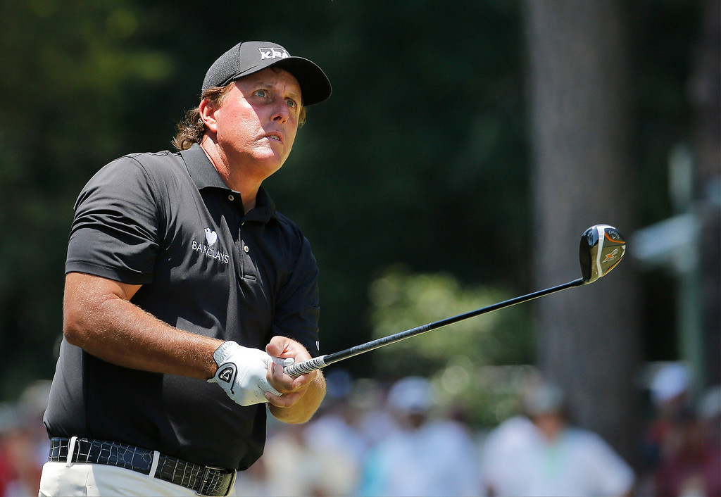 . Phil Mickelson watches his tee shot on the third hole during the final round of the U.S. Open golf tournament in Pinehurst, N.C., Sunday, June 15, 2014. (AP Photo/Matt York)