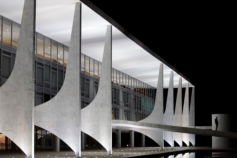 . A security guard walks next to the Planalto Palace on December 5, 2012 designed by Brazilian architect Oscar Niemeyer in Brasilia. Niemeyer, a towering patriarch of modern architecture who shaped the look of modern Brazil and whose inventive, curved designs left their mark on cities worldwide, died late on Wednesday. He was 104. Niemeyer had been battling kidney ailments and pneumonia for nearly a month in a Rio de Janeiro hospital. His death was confirmed by a hospital spokesperson. REUTERS/Ueslei Marcelino