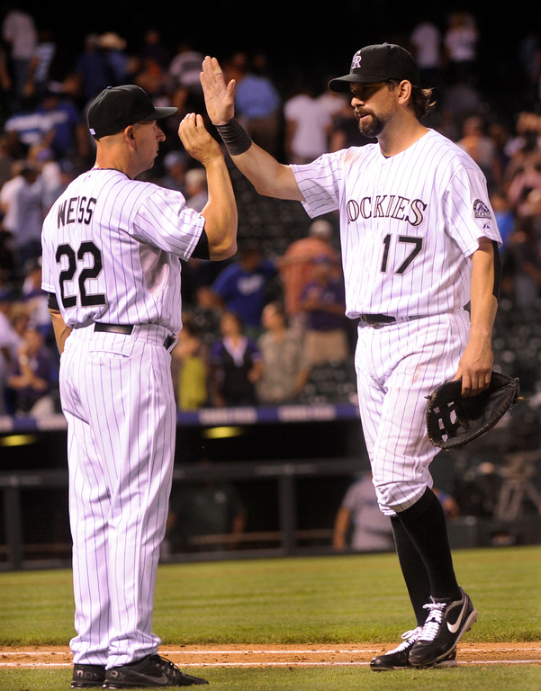 . DENVER, CO. - SEPTEMBER 4: Manager Walt Weiss and Todd Helton celebrated the win Wednesday night. The Colorado Rockies defeated the Los Angeles Dodgers 7-5 at Coors Field Wednesday night, September 4, 2013.  Photo By Karl Gehring/The Denver Post