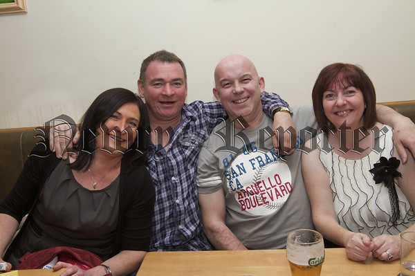 Charity Night in aid of Macmillan Nurses in the Armagh Down Bar on Saturday last.Marcella Mc Evoy, Barry Campbell, Ian and Angela Rooney.10W45N705