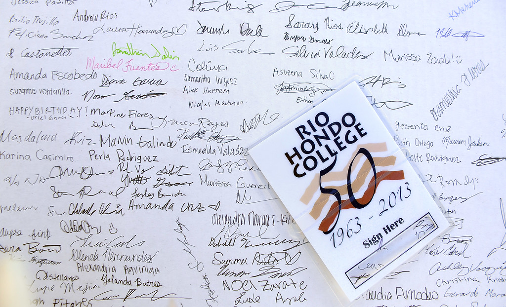 . Hundreds sign a giant birthday card during a celebration of Rio Hondo Colleges 50th anniversary with a time capsule burial, cake and at Rio Hondo College on Thursday, March 14, 2013 in Whittier, Calif.  (Keith Birmingham Pasadena Star-News)