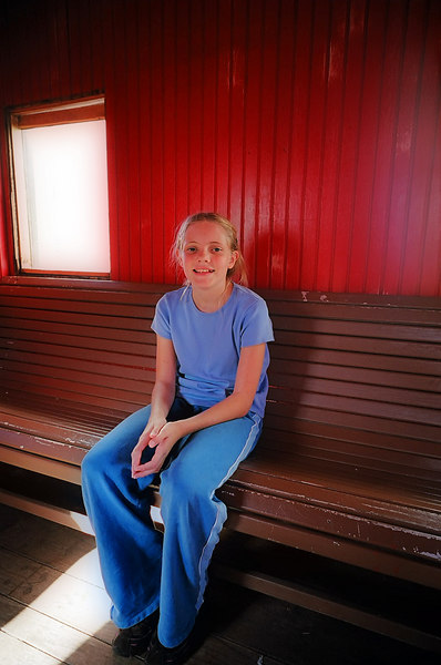 Emily in an historic caboose, maintained by the San Francisco Railroad Club.