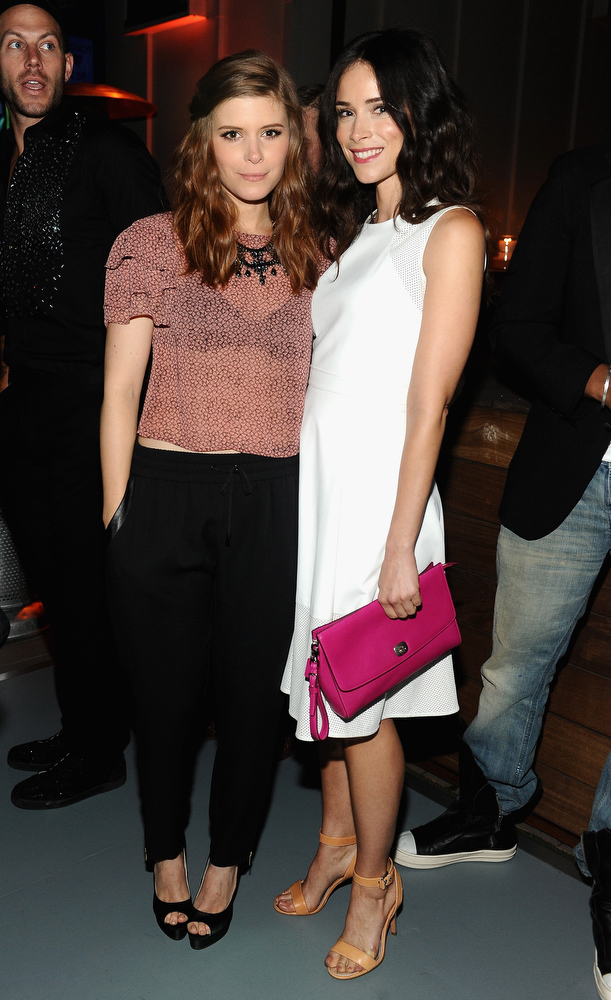 . Actresses Kate Mara (L) and Abigail Spencer attend Coach\'s 3rd Annual Evening of Cocktails and Shopping to Benefit the Children\'s Defense Fund hosted by Katie McGrath, J.J. Abrams and Bryan Burk at Bad Robot on April 10, 2013 in Santa Monica, California.  (Photo by Stefanie Keenan/Getty Images for Coach)
