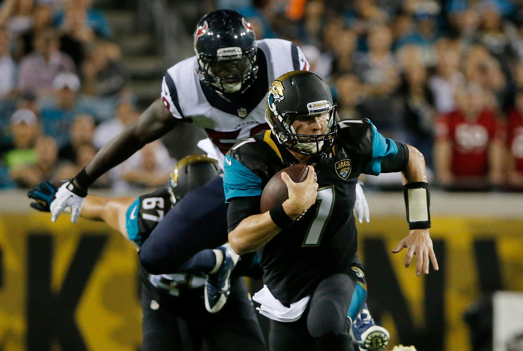 . Chad Henne #7 of the Jacksonville Jaguars scrambles for yardage during the game against the Houston Texans at EverBank Field on December 5, 2013 in Jacksonville, Florida.  (Photo by Sam Greenwood/Getty Images)