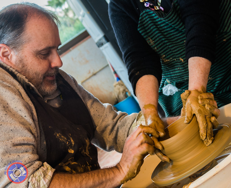 Up to my wrists in clay while working with a master potter (©simon@myeclecticimages.com)