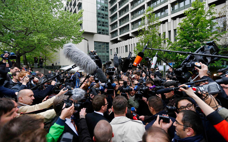 . Journalists surround Semiya Simsek and her brother Enver, children of NSU victim Enver Simsek as they arrive outside the courthouse, where the trial against Beate Zschaepe, a member of the neo-Nazi group National Socialist Underground (NSU), will start later today, in Munich on May 6, 2013. The surviving member of the NSU blamed for a series of racist murders that scandalized Germany and shamed its authorities goes on trial on Monday in one of the most anticipated court cases in recent German history. The trial in Munich will focus on 38-year-old Zschaepe, who is charged with complicity in the murder of eight Turks, a Greek and a policewoman between 2000-2007, as well as two bombings in immigrant areas of Cologne, and 15 bank robberies.  REUTERS/Kai Pfaffenbach