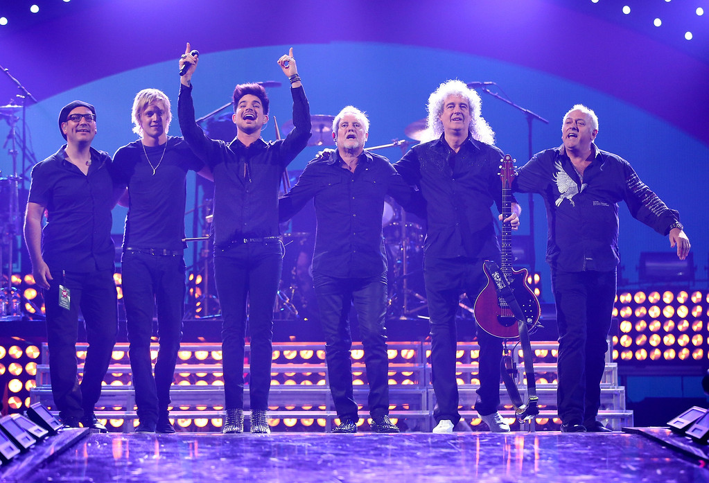 . Adam Labert with Queen pose onstage during the iHeartRadio Music Festival at the MGM Grand Garden Arena on September 20, 2013 in Las Vegas, Nevada.  (Photo by Christopher Polk/Getty Images for Clear Channel)